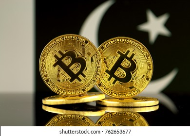 Physical version of Bitcoin and Pakistan Flag. Close up.