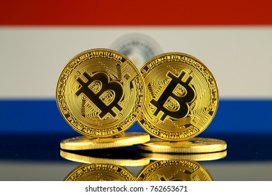 Physical version of Bitcoin and Paraguay Flag. Close up.