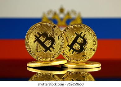 Physical version of Bitcoin and Russia Flag. Close up.