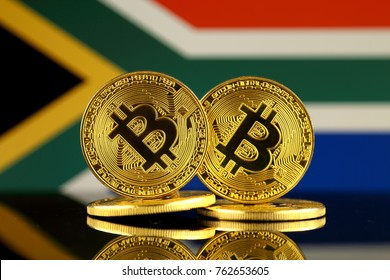 Physical version of Bitcoin and South Africa Flag. Close up.