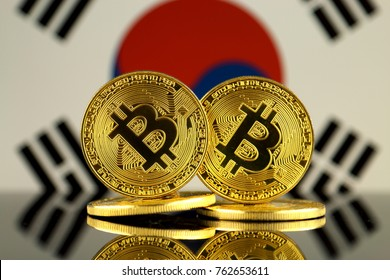 Physical version of Bitcoin and South Korea Flag. Close up.
