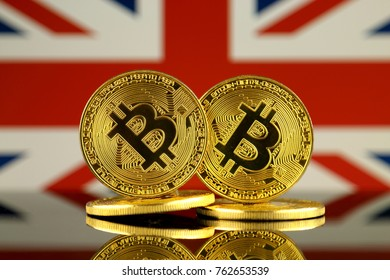 Physical version of Bitcoin and United Kingdom Flag. Close up.