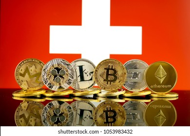 Physical version of Cryptocurrencies (Monero, Ripple, Litecoin, Bitcoin, Dash, Ethereum) and Switzerland Flag.