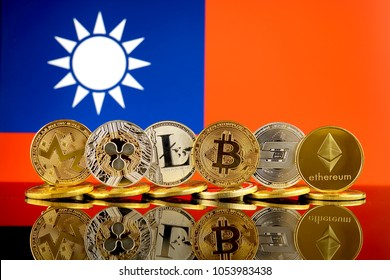 Physical version of Cryptocurrencies (Monero, Ripple, Litecoin, Bitcoin, Dash, Ethereum) and Taiwan Flag.