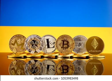 Physical version of Cryptocurrencies (Monero, Ripple, Litecoin, Bitcoin, Dash, Ethereum) and Ukraine Flag.