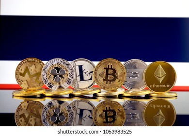 Physical version of Cryptocurrencies (Monero, Ripple, Litecoin, Bitcoin, Dash, Ethereum) and Thailand Flag.