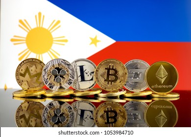 Physical version of Cryptocurrencies (Monero, Ripple, Litecoin, Bitcoin, Dash, Ethereum) and Philippines Flag.