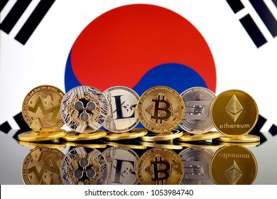 Physical version of Cryptocurrencies (Monero, Ripple, Litecoin, Bitcoin, Dash, Ethereum) and South Korea Flag.