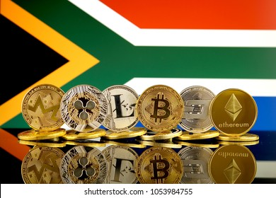 Physical version of Cryptocurrencies (Monero, Ripple, Litecoin, Bitcoin, Dash, Ethereum) and South Africa Flag.