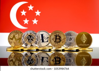 Physical version of Cryptocurrencies (Monero, Ripple, Litecoin, Bitcoin, Dash, Ethereum) and Singapore Flag.