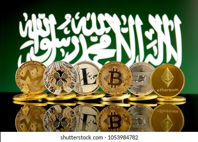 Physical version of Cryptocurrencies (Monero, Ripple, Litecoin, Bitcoin, Dash, Ethereum) and Saudi Arabia Flag.