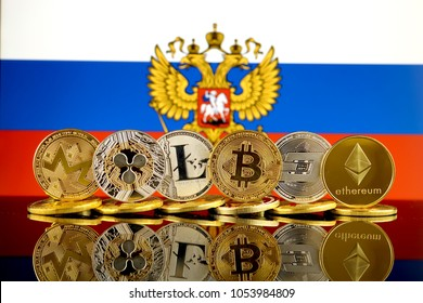 Physical version of Cryptocurrencies (Monero, Ripple, Litecoin, Bitcoin, Dash, Ethereum) and Russia Flag.