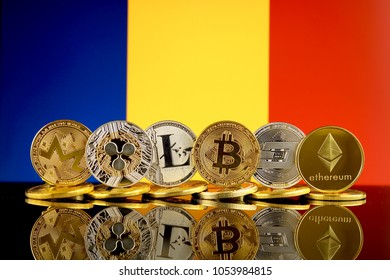 Physical version of Cryptocurrencies (Monero, Ripple, Litecoin, Bitcoin, Dash, Ethereum) and Romania Flag.
