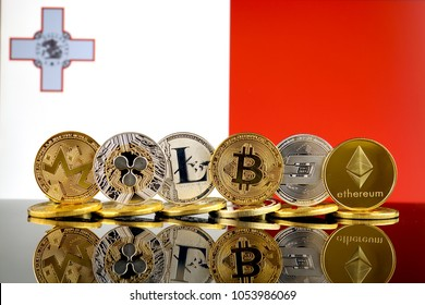 Physical version of Cryptocurrencies (Monero, Ripple, Litecoin, Bitcoin, Dash, Ethereum) and Malta Flag.