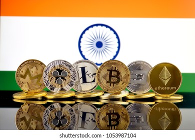 Physical version of Cryptocurrencies (Monero, Ripple, Litecoin, Bitcoin, Dash, Ethereum) and India Flag.
