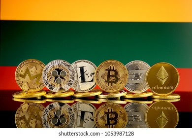 Physical version of Cryptocurrencies (Monero, Ripple, Litecoin, Bitcoin, Dash, Ethereum) and Lithuania Flag.