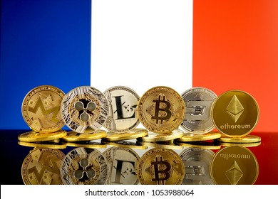 Physical version of Cryptocurrencies (Monero, Ripple, Litecoin, Bitcoin, Dash, Ethereum) and France Flag.