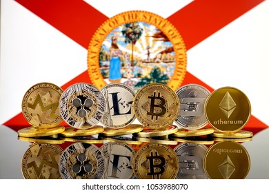 Physical version of Cryptocurrencies (Monero, Ripple, Litecoin, Bitcoin, Dash, Ethereum) and Florida State Flag.