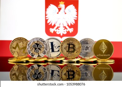 Physical version of Cryptocurrencies (Monero, Ripple, Litecoin, Bitcoin, Dash, Ethereum) and Poland Flag.