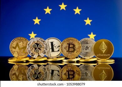 Physical version of Cryptocurrencies (Monero, Ripple, Litecoin, Bitcoin, Dash, Ethereum) and European Union Flag.