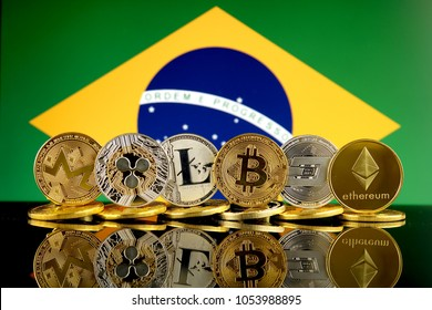 Physical version of Cryptocurrencies (Monero, Ripple, Litecoin, Bitcoin, Dash, Ethereum) and Brazil Flag.
