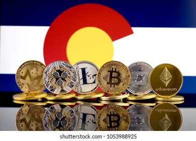 Physical version of Cryptocurrencies (Monero, Ripple, Litecoin, Bitcoin, Dash, Ethereum) and Colorado State Flag.