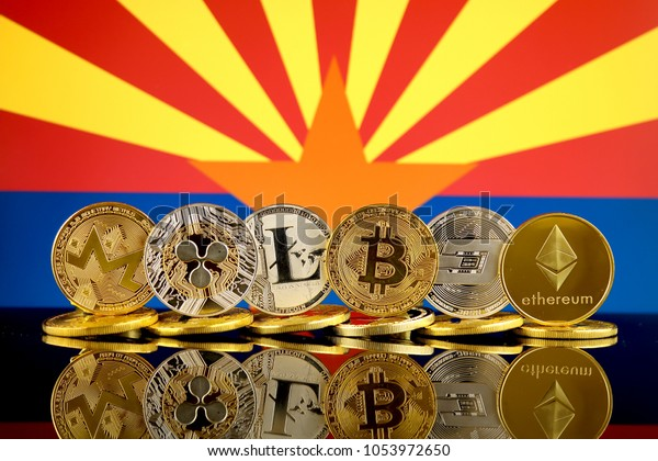 Physical version of Cryptocurrencies (Monero, Ripple, Litecoin, Bitcoin, Dash, Ethereum) and Arizona State Flag.