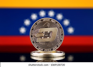Physical version of Dash (DASH), new virtual money and Venezuela Flag. Conceptual image for worldwide cryptocurrency and digital payment system. Studio shot.