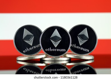 Physical version of Ethereum (ETH) and Austria Flag. Conceptual image for investors in cryptocurrency, Blockchain Technology, Smart Contracts, Personal Tokens and Initial Coin Offering.