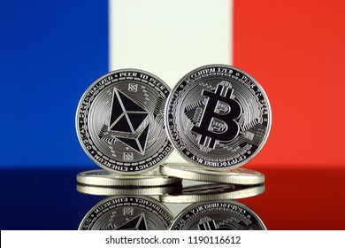 Physical version of Ethereum (ETH), Bitcoin (BTC) and France Flag. 2 largest cryptocurrencies in terms of market capitalization.