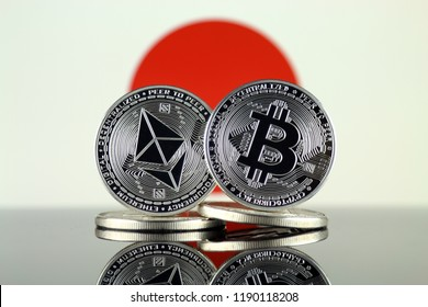 Physical version of Ethereum (ETH), Bitcoin (BTC) and Japan Flag. 2 largest cryptocurrencies in terms of market capitalization.