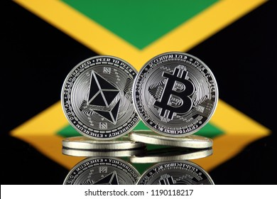 Physical version of Ethereum (ETH), Bitcoin (BTC) and Jamaica Flag. 2 largest cryptocurrencies in terms of market capitalization.