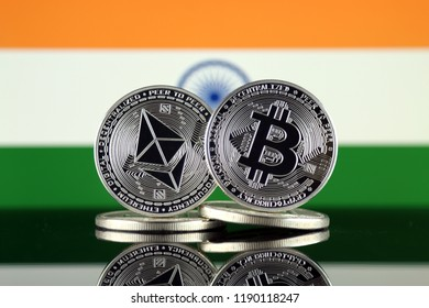 Physical version of Ethereum (ETH), Bitcoin (BTC) and India Flag. 2 largest cryptocurrencies in terms of market capitalization.