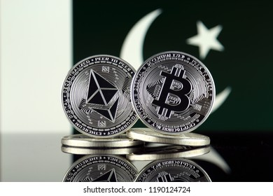 Physical version of Ethereum (ETH), Bitcoin (BTC) and Pakistan Flag. 2 largest cryptocurrencies in terms of market capitalization.