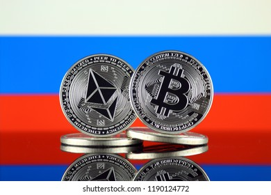 Physical version of Ethereum (ETH), Bitcoin (BTC) and Russia Flag. 2 largest cryptocurrencies in terms of market capitalization.