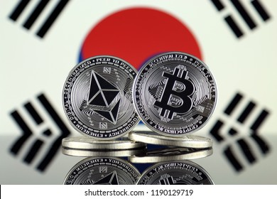 Physical version of Ethereum (ETH), Bitcoin (BTC) and South Korea Flag. 2 largest cryptocurrencies in terms of market capitalization.