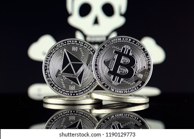Physical version of Ethereum (ETH), Bitcoin (BTC) and Pirate Flag. 2 largest cryptocurrencies in terms of market capitalization. Risk, safety and security.