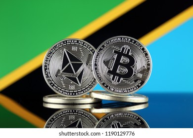 Physical version of Ethereum (ETH), Bitcoin (BTC) and Tanzania Flag. 2 largest cryptocurrencies in terms of market capitalization.