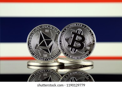 Physical version of Ethereum (ETH), Bitcoin (BTC) and Thailand Flag. 2 largest cryptocurrencies in terms of market capitalization.