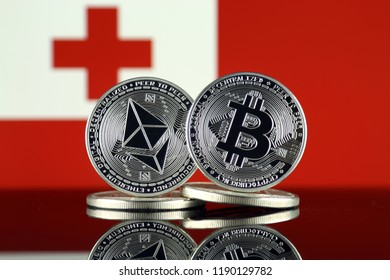 Physical version of Ethereum (ETH), Bitcoin (BTC) and Tonga Flag. 2 largest cryptocurrencies in terms of market capitalization.