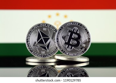 Physical version of Ethereum (ETH), Bitcoin (BTC) and Tajikistan Flag. 2 largest cryptocurrencies in terms of market capitalization.