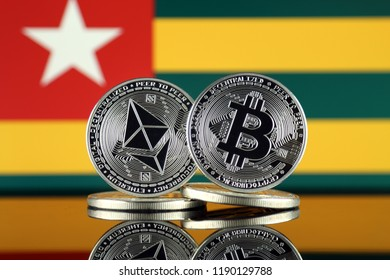 Physical version of Ethereum (ETH), Bitcoin (BTC) and Togo Flag. 2 largest cryptocurrencies in terms of market capitalization.