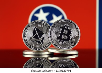 Physical version of Ethereum (ETH), Bitcoin (BTC) and Tennessee State Flag. 2 largest cryptocurrencies in terms of market capitalization.