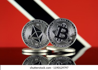 Physical version of Ethereum (ETH), Bitcoin (BTC) and Trinidad and Tobago Flag. 2 largest cryptocurrencies in terms of market capitalization.