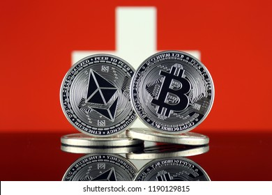 Physical version of Ethereum (ETH), Bitcoin (BTC) and Switzerland Flag. 2 largest cryptocurrencies in terms of market capitalization.