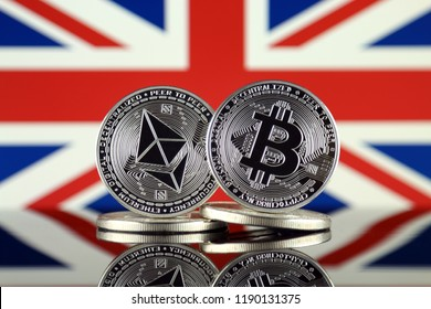 Physical version of Ethereum (ETH), Bitcoin (BTC) and United Kingdom Flag. 2 largest cryptocurrencies in terms of market capitalization.