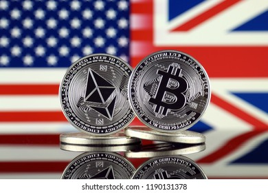 Physical version of Ethereum (ETH), Bitcoin (BTC), United States and United Kingdom Flag. 2 largest cryptocurrencies in terms of market capitalization.
