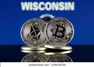 Physical version of Ethereum (ETH), Bitcoin (BTC) and Wisconsin State Flag. 2 largest cryptocurrencies in terms of market capitalization.
