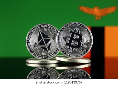 Physical version of Ethereum (ETH), Bitcoin (BTC) and Zambia Flag. 2 largest cryptocurrencies in terms of market capitalization.