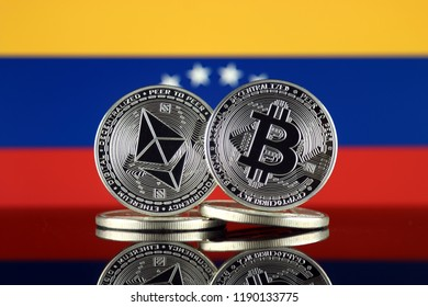 Physical version of Ethereum (ETH), Bitcoin (BTC) and Venezuela Flag. 2 largest cryptocurrencies in terms of market capitalization.